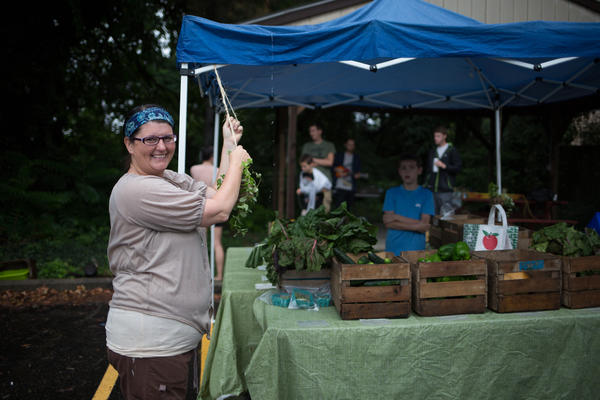 "Kate Marshall of Grow Ohio Valley beside the ""Farmacy"" stand at Health Right Wheeling"