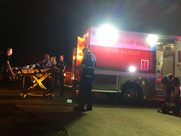 Delray Beach Fire Rescue personnel transport an overdose victim to the hospital on Nov. 18, 2016.