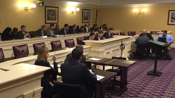 Democrats and Republicans sit on the transportation budget bill conference committee.