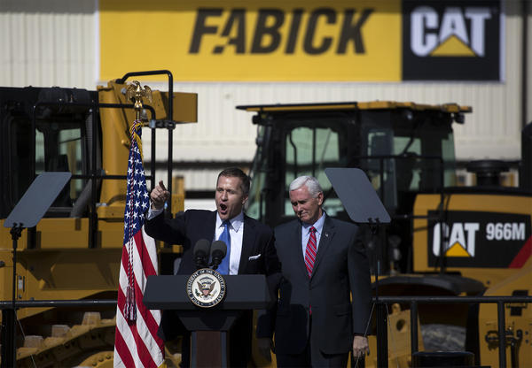 Gov. Eric Greitens introduces Vice President Mike Pence at Fabick Cat last month.