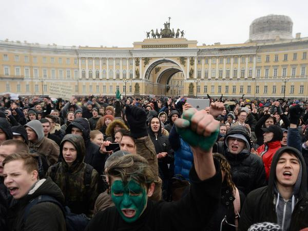 Protesters participate in an anti-corruption rally in St. Petersburg on March 26. Thousands of Russians demonstrated across the country to protest corruption.