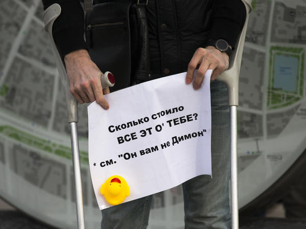 "A man holds a poster saying ""How Much Did it Cost You?"" with a yellow duck toy in downtown Moscow on Sunday. The protests focused on reports claiming that Prime Minister Dmitry Medvedev has amassed a collection of mansions, yachts and vineyards — and a house for raising ducks."