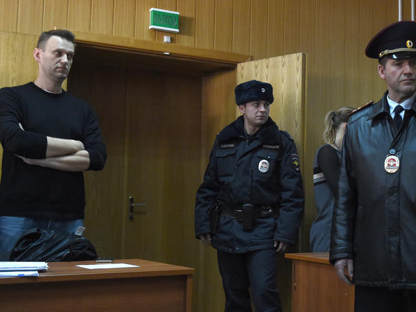 "Kremlin critic Alexei Navalny (left), who was arrested during a March 26 anti-corruption rally, attends a hearing at a court in Moscow on Monday. He was sentenced to 15 days behind bars and fined Monday after he and more than 1,000 other demonstrators were detained at an anti-corruption protest in Moscow that was branded a ""provocation"" by the Kremlin."