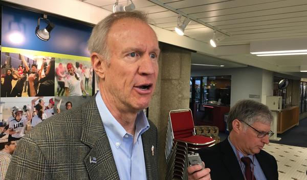 Gov. Bruce Rauner speaks with reporters in Springfield on Wednesday, March 28, 2017.