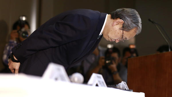 Toshiba Corp. President Satoshi Tsunakawa bows during a press conference at the company's headquarters in Tokyo on Wednesday. Toshiba says its American nuclear unit Westinghouse Electric has filed for bankruptcy protection.