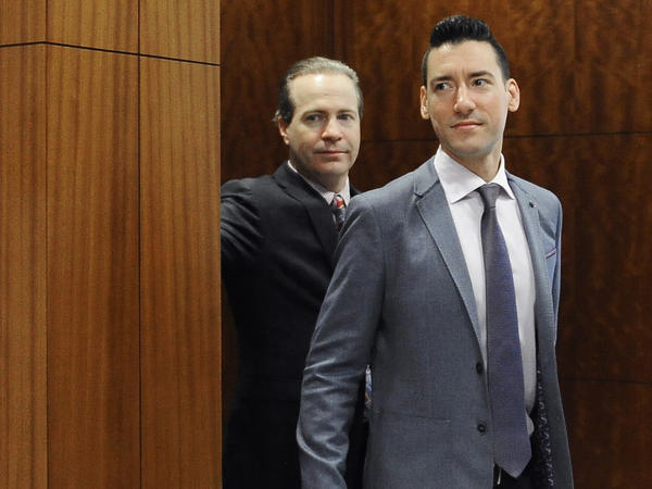 David Robert Daleiden (right) leaves a courtroom after a hearing in Houston. California prosecutors say two anti-abortion rights activists who made undercover videos of themselves trying to buy fetal tissue from Planned Parenthood have been charged with 15 felony counts of invasion of privacy. State Attorney General Xavier Becerra announced the charges Tuesday.