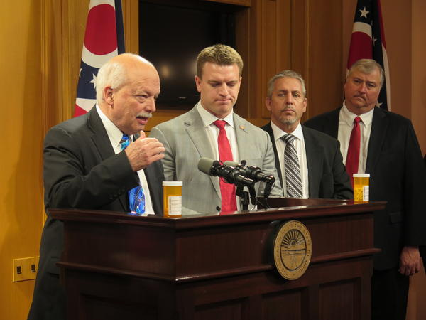 L-R Republican State Senator Bob Hackett, Republican State Representative Jay Edwards, Scott Weidle, father of son who died from overdose of opioids, Republican State Representative Larry Householder