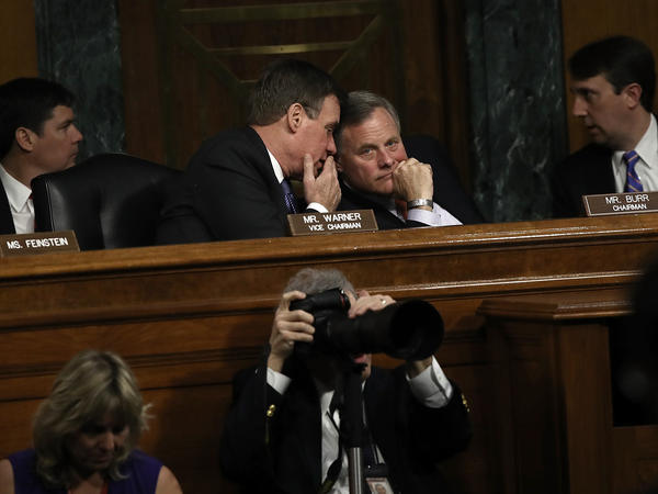 Senate Select Intelligence Committee Chairman Sen. Richard Burr, right, confers with ranking member Sen. Mark Warner, left, during a hearing of the Senate Select Intelligence Committee Thursday in Washington, D.C.