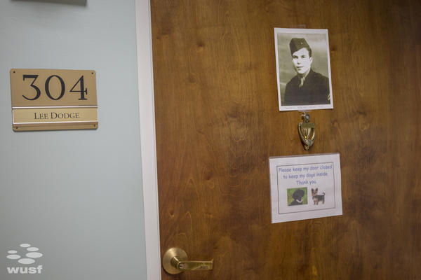 Dodge's door shows off his veteran pride, and Huey, his beloved Yorkie.