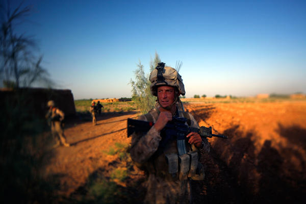 <p>Darryl St. George was a high school teacher on Long Island before becoming a Navy corpsman. In June, he was serving in southern Afghanistan. He's back in the U.S. for the time being and has visited his former school.</p>