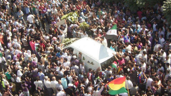 <p>Mourners surround the hearse carrying the coffin of Kurdish opposition leader Meshaal al-Tammo during his funeral last Sunday in Amuda, in northern Syria. Supporters blamed the Syrian government for his death. </p>