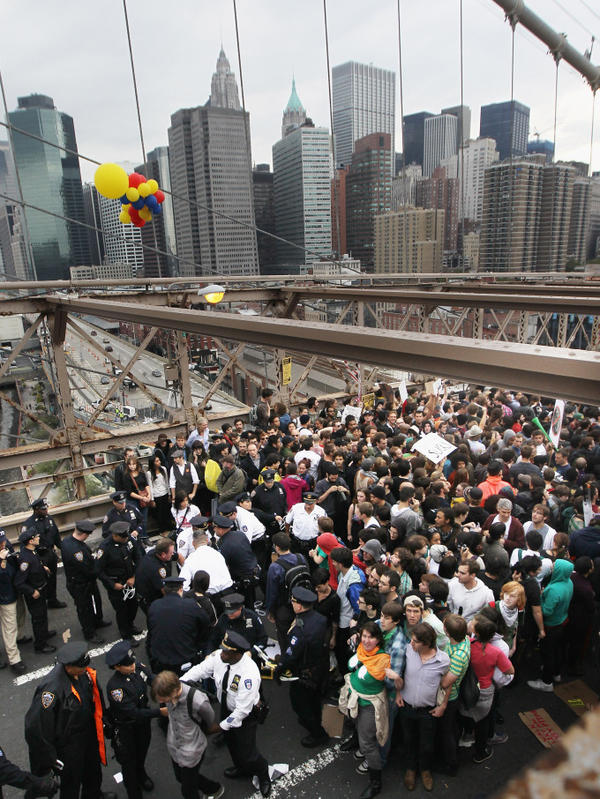 <p>Police arrest two Occupy Wall Street demonstrators after they tried to cross the Brooklyn Bridge on Oct. 1. Media coverage spiked after the incident.</p>