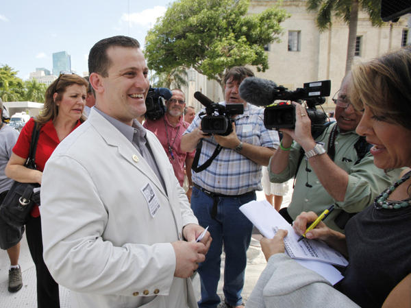 <p>Nezar Hamze, director of the Council on American-Islamic Relations in South Florida, talks to members of the media in May. Hamze says he wants to talk to Rep. Allen West about the congressman's views on Islam and discuss the larger context of the passages he sometimes quotes from the Quran.</p>