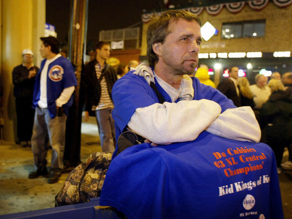 <p>Ted Zegarski and other dejected Cubs fans hang out in front of Wrigley Field as the Chicago Cubs were beaten by the Florida Marlins in Game 7 of the National League Championship Series on Oct. 15, 2003.</p>