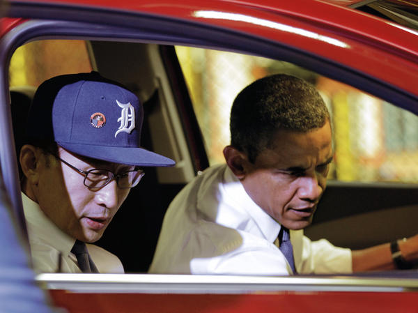 <p>President Obama and South Korean President Lee Myung-bak, wearing a Detroit Tigers baseball cap, check out the interior of the subcompact Chevrolet Sonic during their tour.</p>