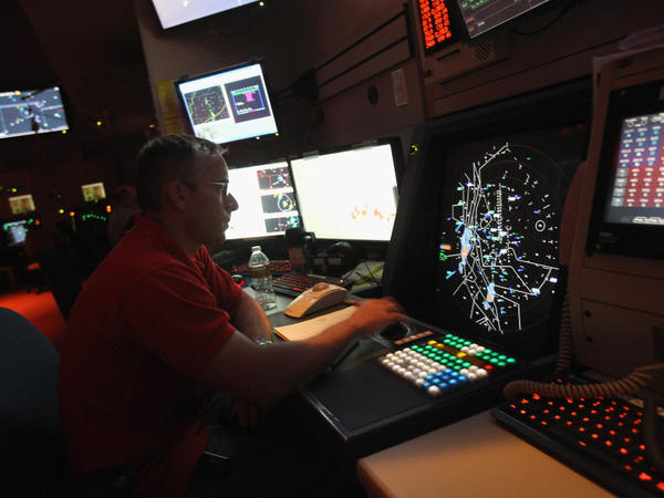 <p>An air traffic controller monitors flights in July at the Denver International Airport. The Federal Aviation Administration is planning to modernize its traffic control system, but has faced a number of obstacles.</p>