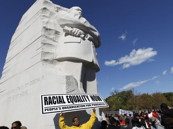 <p>Demonstrators rally under the new Martin Luther King Jr. memorial in Washington, D.C., on Saturday.</p>