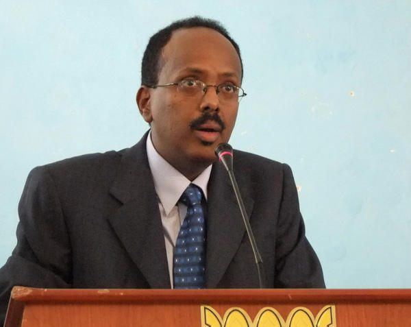 <p>Mohamed Abdullahi Mohamed addresses officials after being sworn in as interim prime minister of Somalia last November. </p>