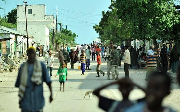 <p>Residents walk along a busy street in Somalia's capital, Mogadishu, on Oct. 6. After four years of bitter battles, African Union-backed government troops forced the militant group al-Shabab to pull out of the city.</p>