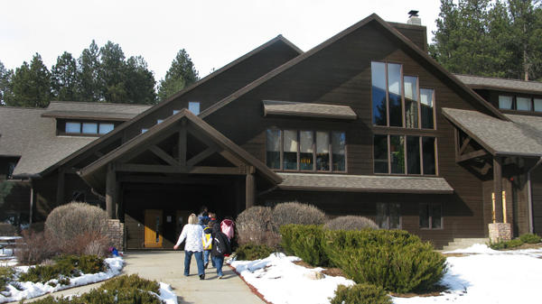 <p>Children at the Black Hills campus of the Children's Home Society head into the main building for lunch. The home caters to children with special needs, many of whom are Native American.</p>