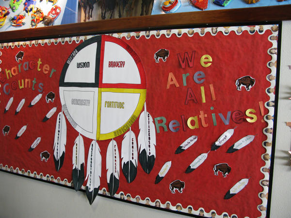 <p>Children's artwork lines the halls of the Children's Home Society in South Dakota. Officials there say they try to keep Native American kids connected to their culture.</p>