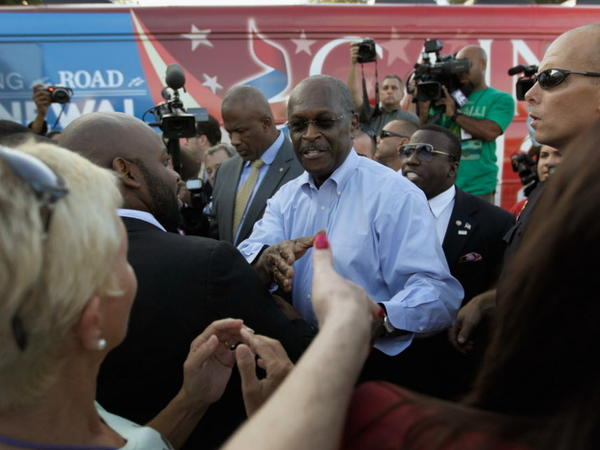 Republican Presidential candidate Herman Cain greets supporters at a campaign rally outside of Wings Plus on Wednesday in Coral Springs, Fla.