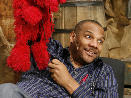 Elmo and Clash, on the <em>Sesame Street</em> set in 2006.