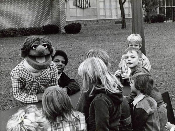 Kevin Clash (center) started making puppets when he was a teenager in Baltimore.