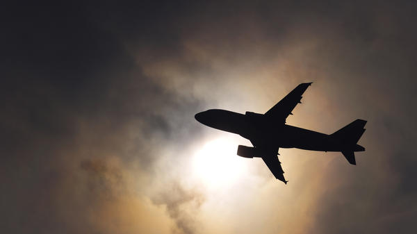 Air travel contributes only 2 to 4 percent of carbon dioxide emissions worldwide. A new ruling says airlines flying into and out of European airports will have to pay a price for the carbon dioxide they emit from burning jet fuel. Above, a plane takes off from the Geneva airport last year.