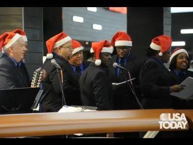 TSA workers sing at Los Angeles International Airport in this screen grab from a <em>USA Today</em> video. The chorus dons Santa hats during the holiday season and perform in the middle of the airport.