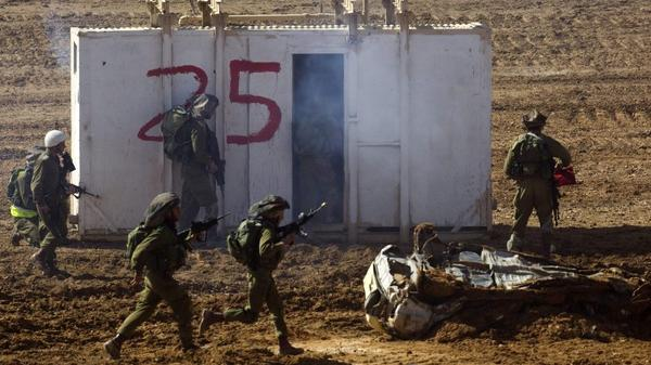 Israeli soldiers take part in an exercise at the Shizafon army base, in the Negev Desert north of the southern city of Eilat, on Tuesday. There are growing signs that Israel may be planning a strike against Iran's nuclear facilities.