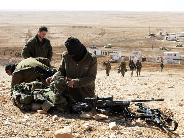 Israeli army snipers pack their gear after an army exercise at the Shizafon army base, in the Negev Desert north of the southern city of Eilat, on Tuesday.