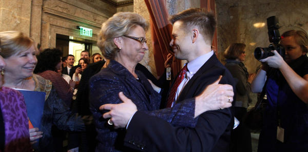 Gov. Chris Gregoire (left) embraces Rep. Jamie Pedersen, a Seattle Democrat, after the Washington state House voted Wednesday to legalize gay marriage.