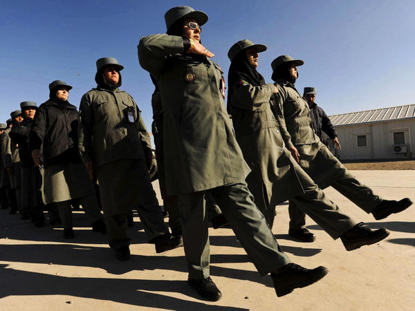 Afghan female police officers march at the Police Training Center on the outskirts of Herat province in western Afghanistan on Dec. 8.