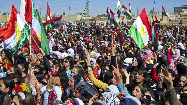 Kurds in Syria overwhelmingly oppose the current Syrian regime but have been hesitant to join in the fighting. Here, Kurds wave the Kurdish flag as they rally against the government in the northern city of Qamishli, Syria, on March 21.