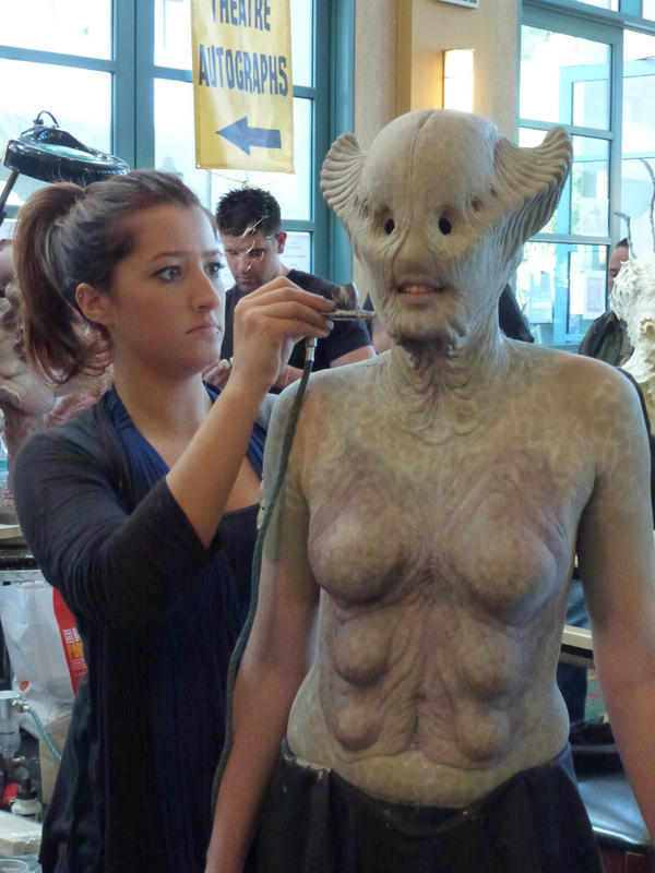A makeup artist demonstrates her skills at Monsterpalooza.