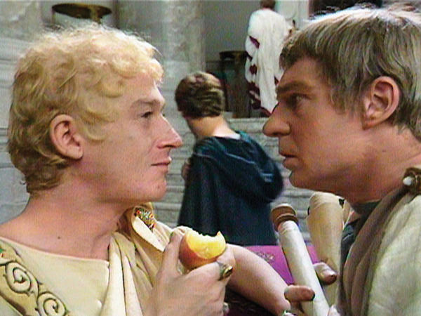 John Hurt (Caligula) and Derek Jacobi (Claudius) square off in the miniseries <em>I, Claudius.</em>