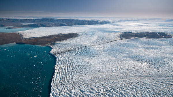 Researchers studying Greenland's ice say it is melting more slowlyl than previously thought. Here, ice travels down a relatively small outlet glacier into the sea.