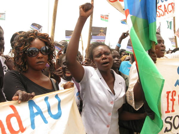 Student Gloria Emmanuel (center) speaks for many South Sudanese who claim Sudan, and its president, Omar Hassan Al Bashir, have declared war on the South.