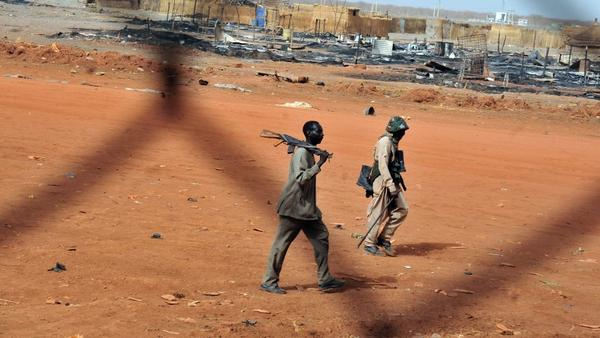 Sudanese soldiers walk in the oil town of Heglig on April 24. South Sudanese forces occupied Heglig last month. The international community called on the South to pull out, which it says it did.