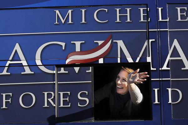 Rep. Michele Bachmann of Minnesota waves from her bus following a campaign stop Monday in West Des Moines, Iowa.