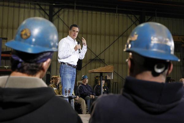 Former Massachusetts Gov. Mitt Romney speaks during a rally at Missouri Valley Steel in Sioux City, Iowa, Friday, Dec. 16, 2011.