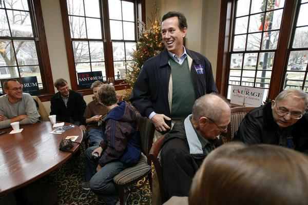 Former Pennsylvania Senator Rick Santorum greets local residents during a campaign stop at the Monarch restaurant, Tuesday, Dec. 20, 2011, in Pella, Iowa.