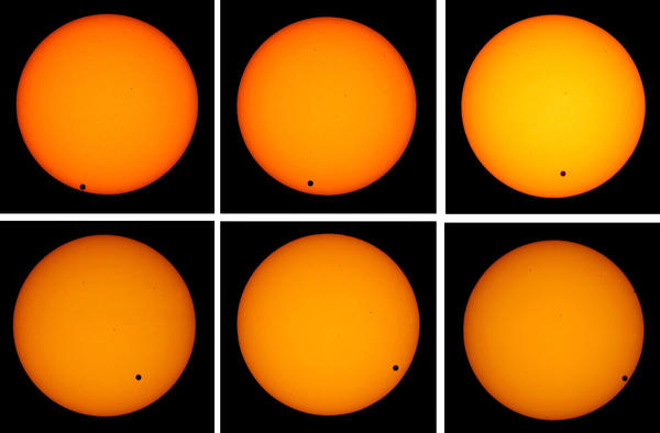 <strong>The Transit Of Venus:</strong> The planet Venus appears as a tiny black dot as it transits across the face of the sun on June 8, 2004. The rare astronomical event will take place again on June 5, 2012.