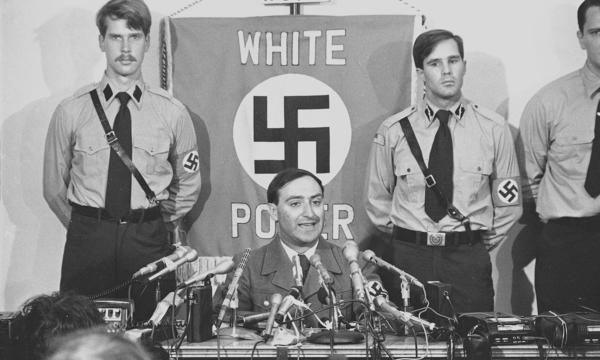 Frank Collin, head of the National Socialist Party of America, tells the press about his organization's plans to march in the predominantly Jewish town of Skokie, Ill., on June 22, 1978. The Supreme Court affirmed the neo-Nazi organization's right to march, but Jeremy Waldron says that's just the kind of speech the government should be restricting.