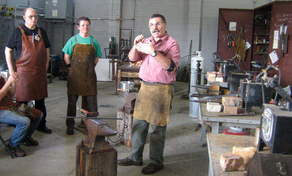Mark Aspery (right) teaches a blacksmith class at Adam's Forge in Los Angeles.