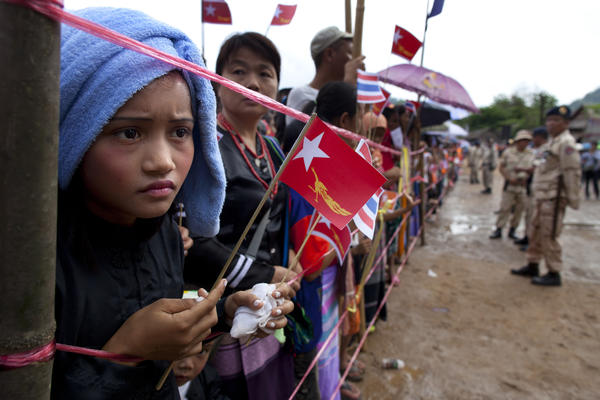 Ethnic Karen refugees waited hours for Suu Kyi to arrive at the Mae La refugee camp.