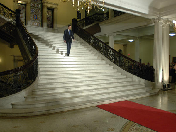 Romney walks down the central staircase inside the Statehouse during a ceremony marking the end of his term as governor on Jan. 3, 2007.