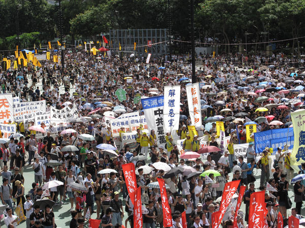Huge crowds pack Hong Kong's Victoria park, marching through the city's streets Sunday to express their dissatisfaction with the new leader.
