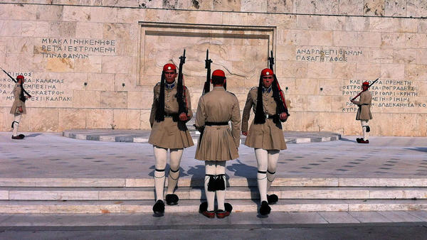<em>Evzones</em>, the Greek honor guard, watch over Syntagma Square in Athens, the site of numerous anti-austerity protests in the last two years.